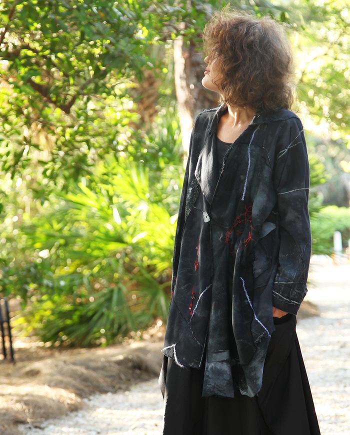 avant-garde asymmetrical black midi jacket