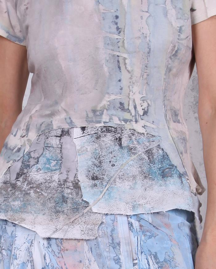 fitted peplum-style hand-painted knit top