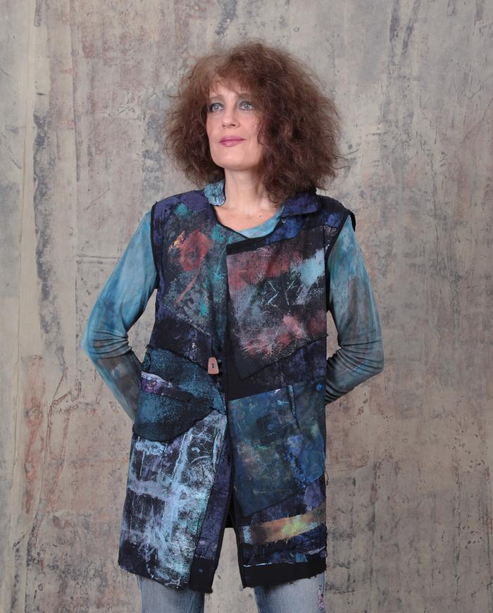 gemstone shades over black patchwork stretch vest