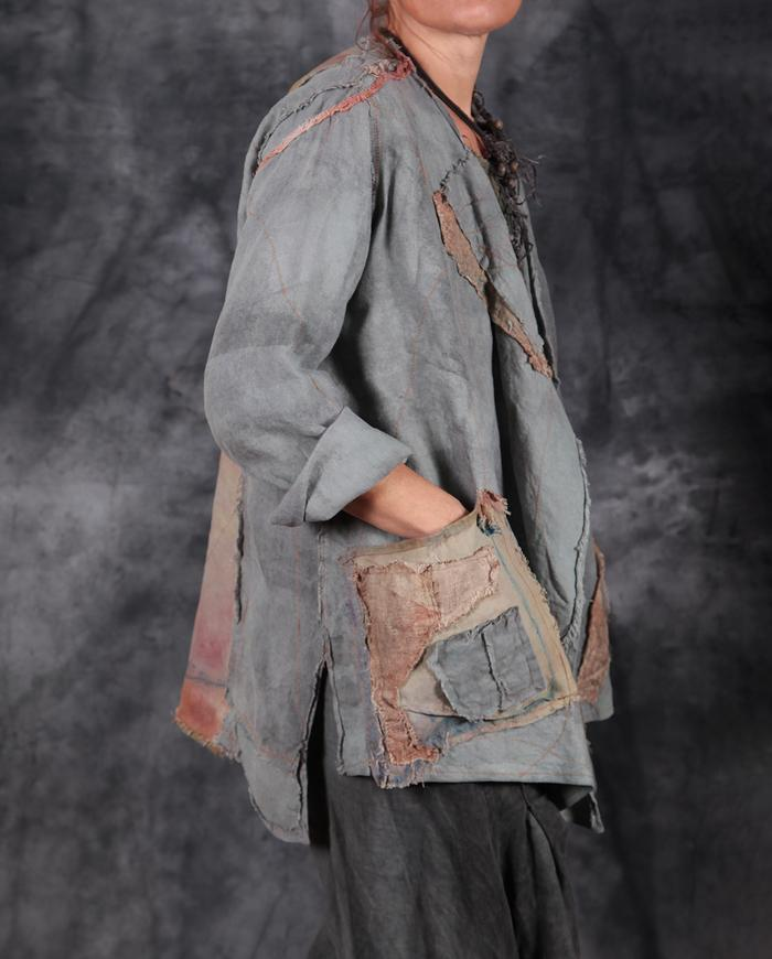 loose-fitting hand-distressed jacket in spring gray with appliqué