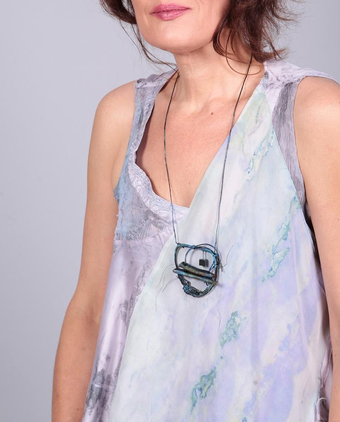 'a circle a day' reversible leather and bead pendant necklace